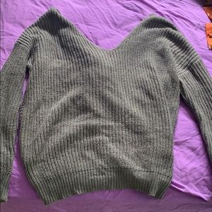 Gray v neck sweater with knot detail in back
